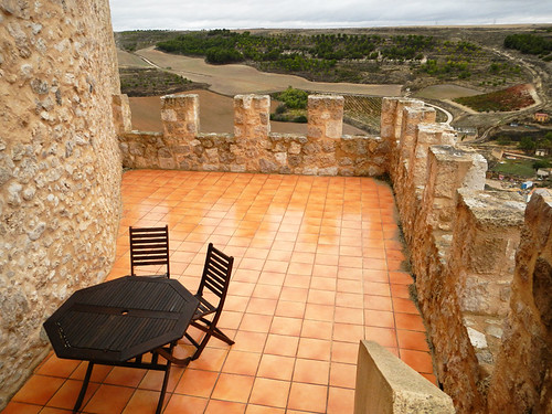 Patio with a view past the crenellations at the Castillo de Curiel, a renovated medieval castle that had been converted into a hotel