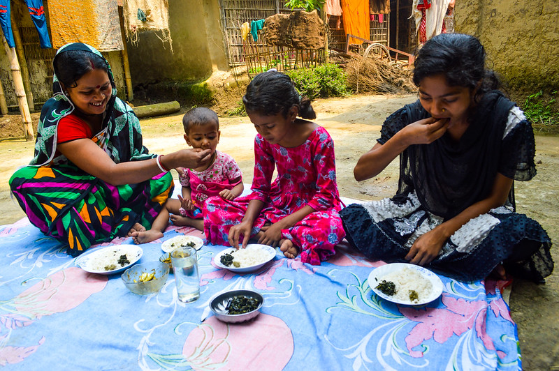 Pronoti Rani and her children are eating nutrition rich small fish in their meal in Moulavibazar, Bangladesh. Photo by Mohammad Mahabubur Rahman.