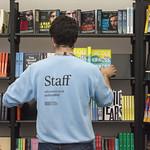 Bookshop staff fill the shelves  