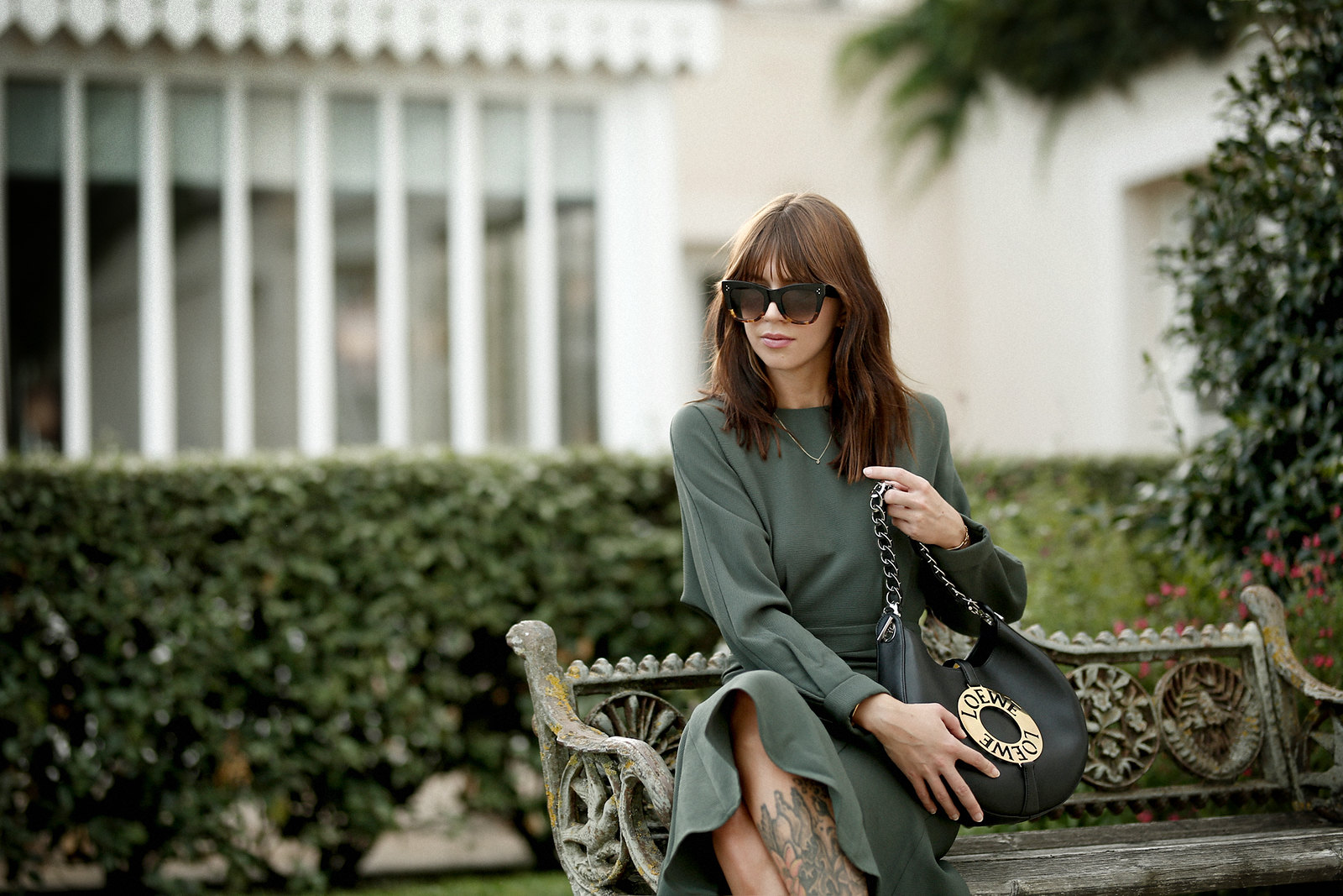 outfit green dress loewe joyce bag breuninger celine sunglasses les sources de caudalie france bordeaux late summer look going out dinner style hermes oran sandals brown minimal french chic parisienne bangs brunette france cats & dogs fashion blogger 6