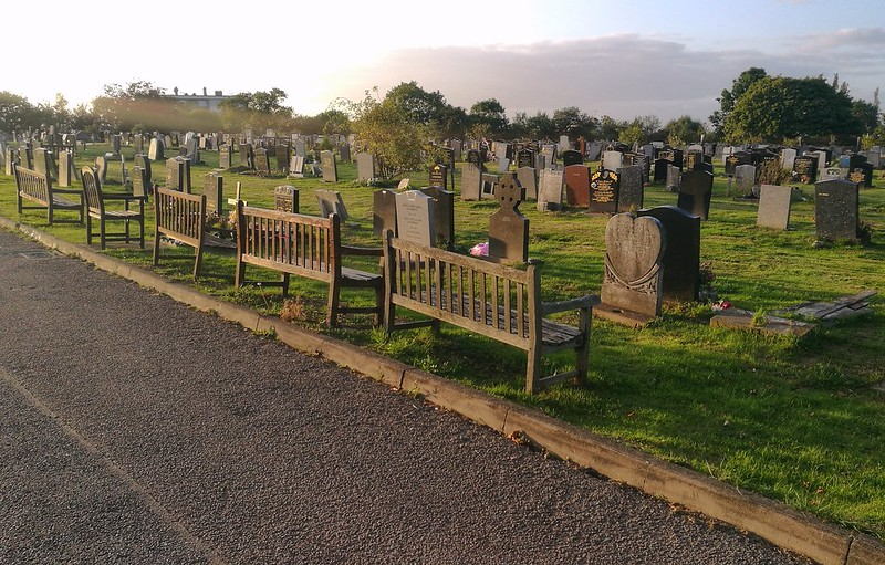 Cemetery benches in the setting sun