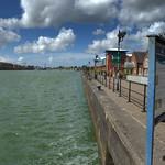 Blue sky and green water at Preston Docks