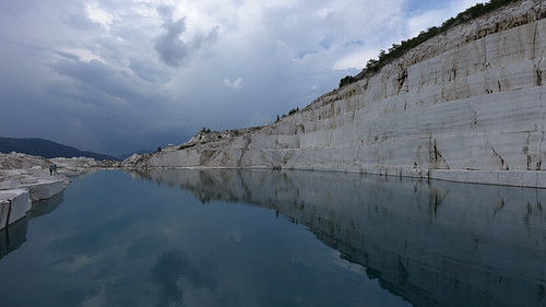 prilep macedonia marmor quarry overcast thunder storm reflection lake water white marble mine excavation mountain sivec belovodica