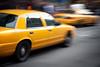 Speeding Yellow Taxi Cabs Motion Blur
