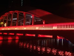 Bridge - Man Made Structure Night Red Architecture Connection Illuminated Built Structure Transportation Business Finance And Industry City Outdoors Road No People Water Cityscape Bridge Red Lights River