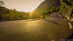 Winding Road Cycling at Sunset