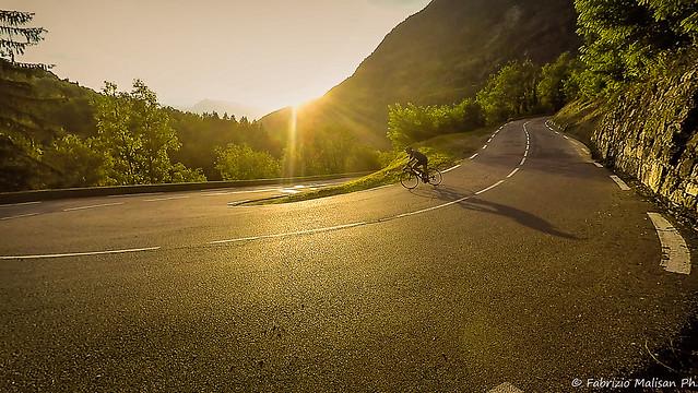 Winding Road Cycling at Sunset