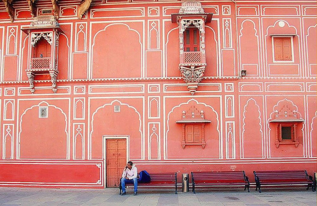 Man sitting inside the compound of the City Palace