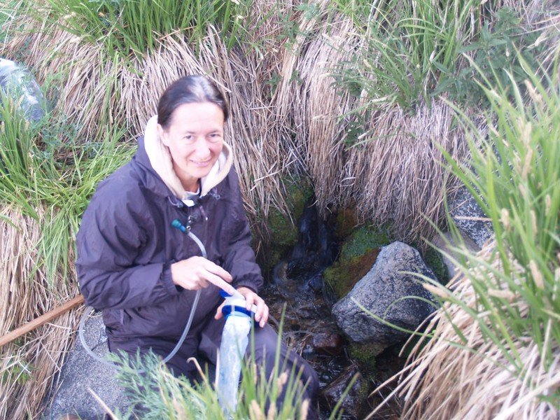 Vicki filtering water from Mineshaft Spring - it was gushing ice cold from the ground