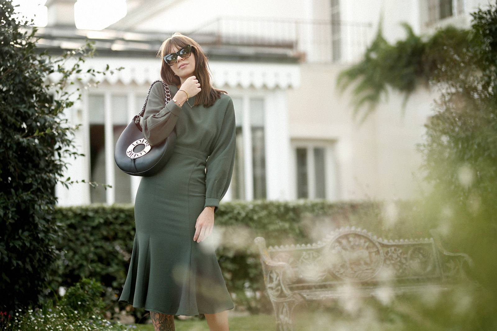 outfit green dress loewe joyce bag breuninger celine sunglasses les sources de caudalie france bordeaux late summer look going out dinner style hermes oran sandals brown minimal french chic parisienne bangs brunette france cats & dogs fashion blogger 1