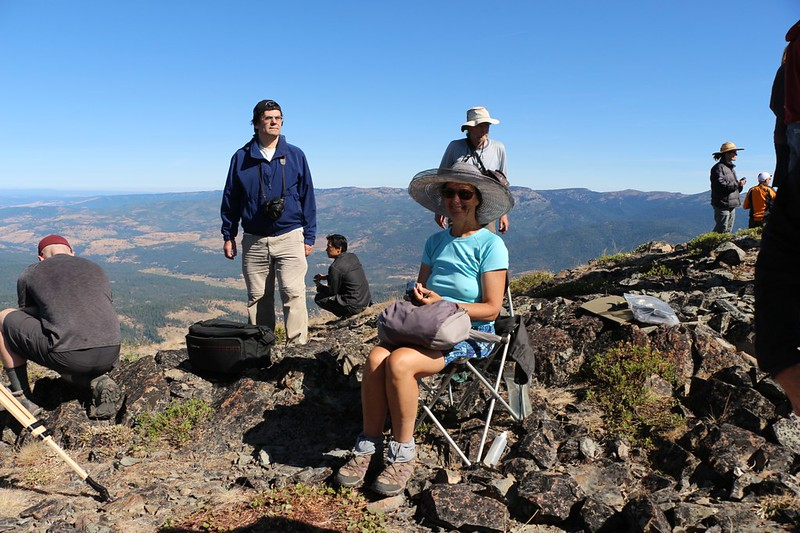 Vicki is seated in her chair on Dixie Butte as both the temperature and light decrease - 12 minutes to go