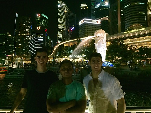 Michael Malloy '18, Rishav Sharma 18', and Will Rosencrans '19 (majoring in Physics) in front of the Merlion park and skyline in downtown Singapore during fall 2017 Singapore exchange