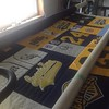 Working on a baseball jersey quilt today. #baseball #tshirtquilt #littleleague #freemotion #navy #yellow
