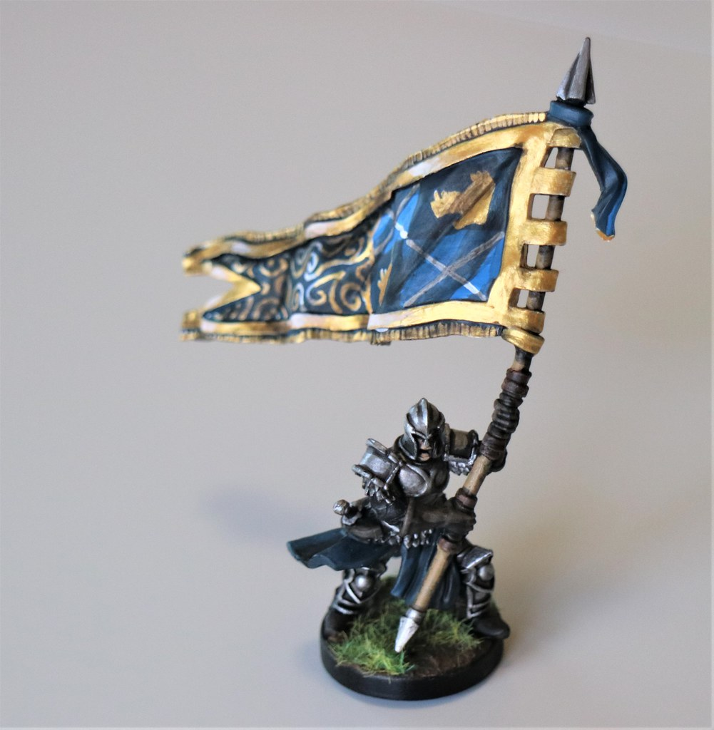 Runewars Miniatures Daqan Flag Bearer