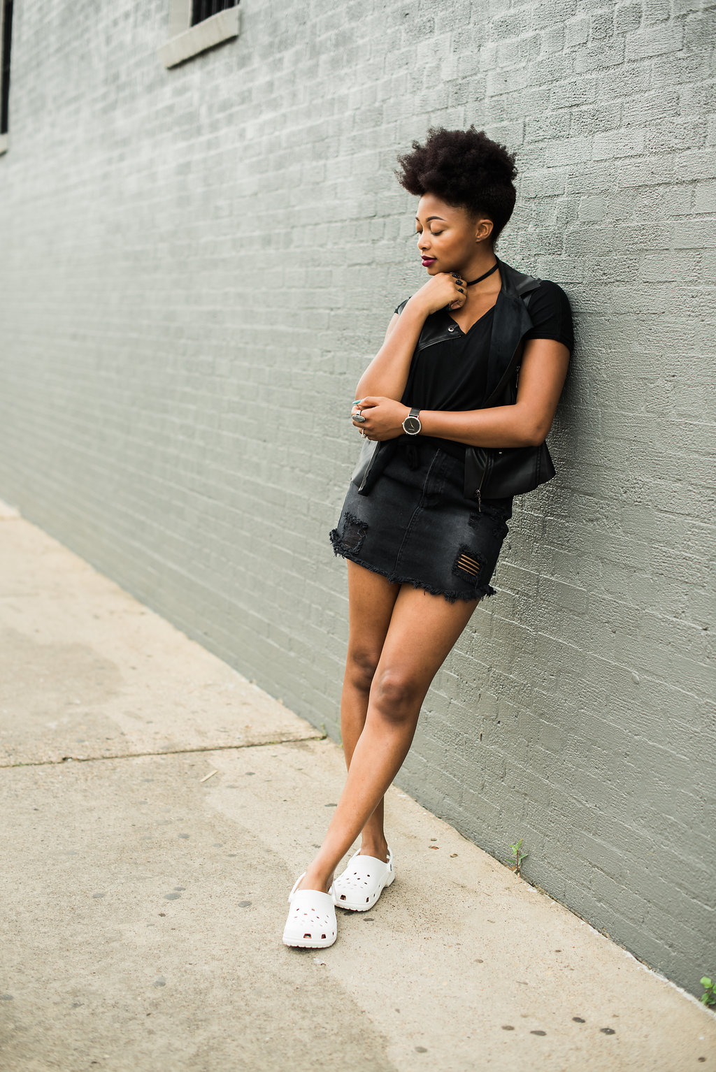 how to wear all black with a pop of white