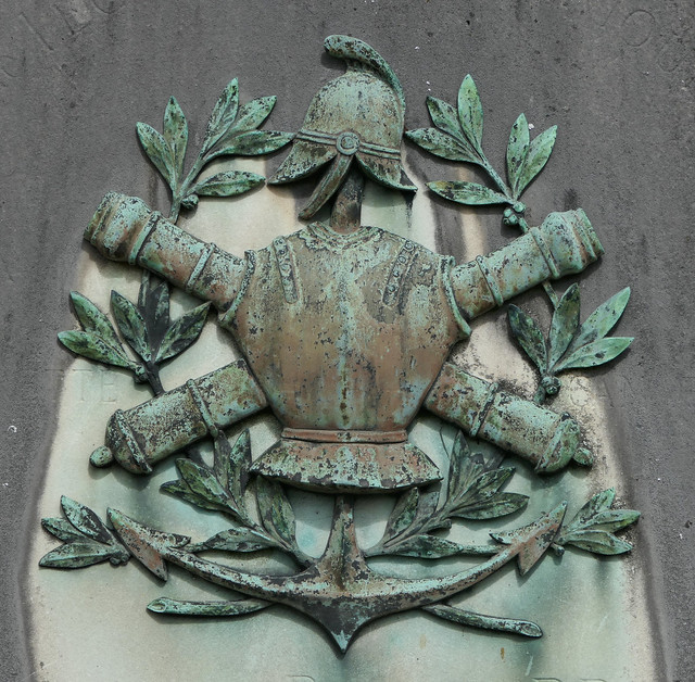 Military symbols relief sculpture on a grave