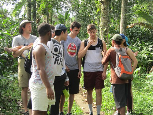 William Rosencrans '19 (majoring in Physics) and Singapore exchange group in fall 2017  trekking in the rainforest of Bali examining some nutmeg fruit found in the jungle.