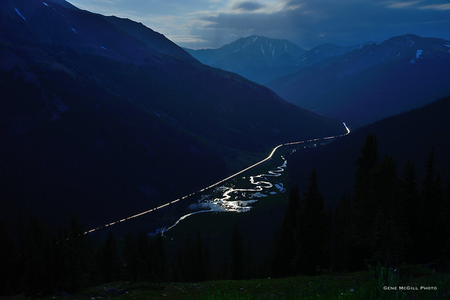 Headlight trails in the moonlight, Independence Pass, Colorado