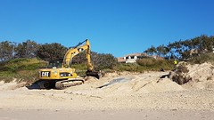 Digger repairing the access to Pippi beach