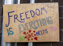 """Freedom - but love helps!"" sign"