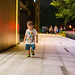 Portrait of baby boy walking in the street