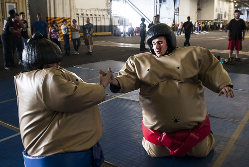 Sun, 08/20/2017 - 22:02 - 170820-N-RZ514-092 ATLANTIC OCEAN (Aug. 20, 2017) Sailors and their guests participate in a 'sumo fight' during a Tiger Cruise in the hangar bay of the aircraft carrier USS George H.W. Bush (CVN 77). The ship and its carrier strike group are transiting home from a scheduled seven-month deployment in support of maritime security operations and theater security cooperation efforts in the U.S. 5th and 6th Fleet areas of responsibility.  (U.S. Navy photo by Mass Communication Specialist Seaman Jennifer M. Kirkman/Released)