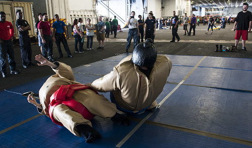 Sun, 08/20/2017 - 22:01 - 170820-N-RZ514-061 ATLANTIC OCEAN (Aug. 20, 2017) Sailors and their guests participate in a 'sumo fight' during a Tiger Cruise in the hangar bay of the aircraft carrier USS George H.W. Bush (CVN 77). The ship and its carrier strike group are transiting home from a scheduled seven-month deployment in support of maritime security operations and theater security cooperation efforts in the U.S. 5th and 6th Fleet areas of responsibility.  (U.S. Navy photo by Mass Communication Specialist Seaman Jennifer M. Kirkman/Released)