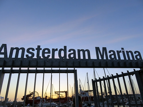 The Amsterdam Marina sign with a gate that leads into the marina