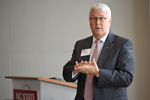Chancellor Randy Woodson speaks at a lunch for the Board of Governors and local business leaders.
