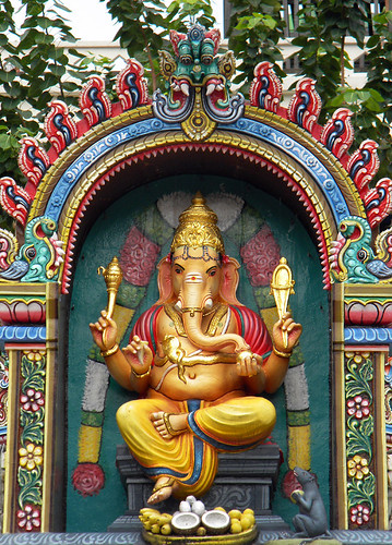 An altar with Ganesh, the boy god with an elephant head in a bright Singapore Hindu temple