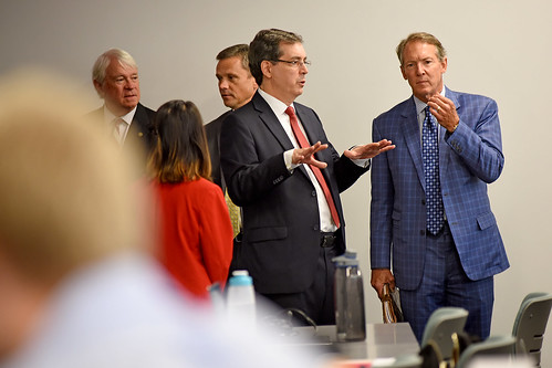 Dr. Michael Rappa, founding director of the Institute for Advanced Analytics (left), tells Board of Governors' member Tom Fetzer about the program while touring an IAA classroom.