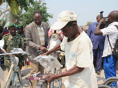 Kalemie, Tanganyika Province: International day of indigenous peoples - A member of Baraza (local peace Committee) from Mbayo in the Manono territory of the Twa community, receives the head of Office of MONUSCO Kalemie on a bike.