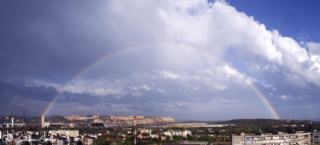 Panorama with double rainbow