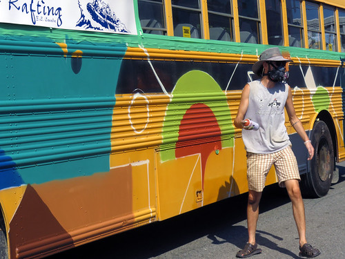 Spray-painting a bus at the Mural Fest in Vancouver