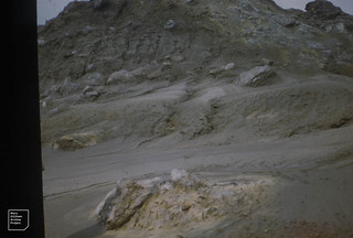 White Island volcano suphur deposits on warm mud floes through a break in the fumes, Bay of Plenty, 1957