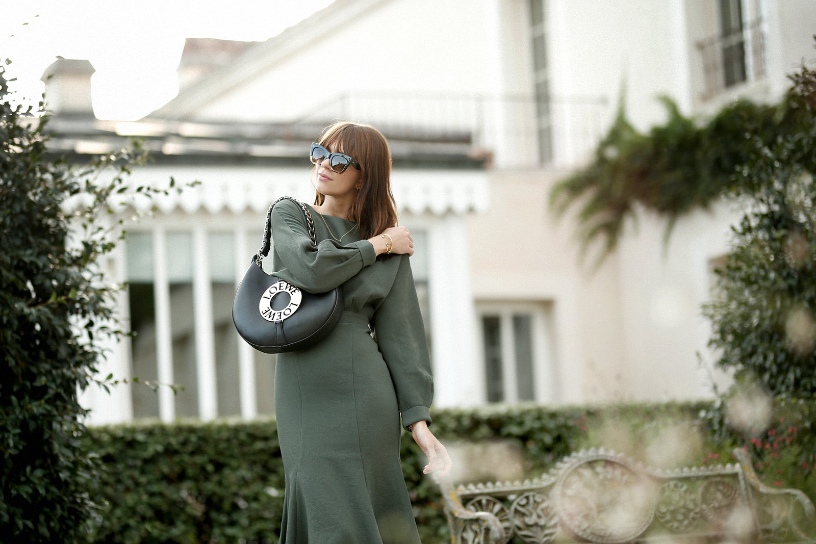 outfit green dress loewe joyce bag breuninger celine sunglasses les sources de caudalie france bordeaux late summer look going out dinner style hermes oran sandals brown minimal french chic parisienne bangs brunette france cats & dogs fashion blogger 8