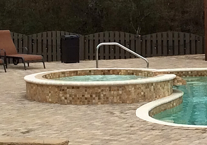 The 8' round spill over spa featured in Sandstone Beige.