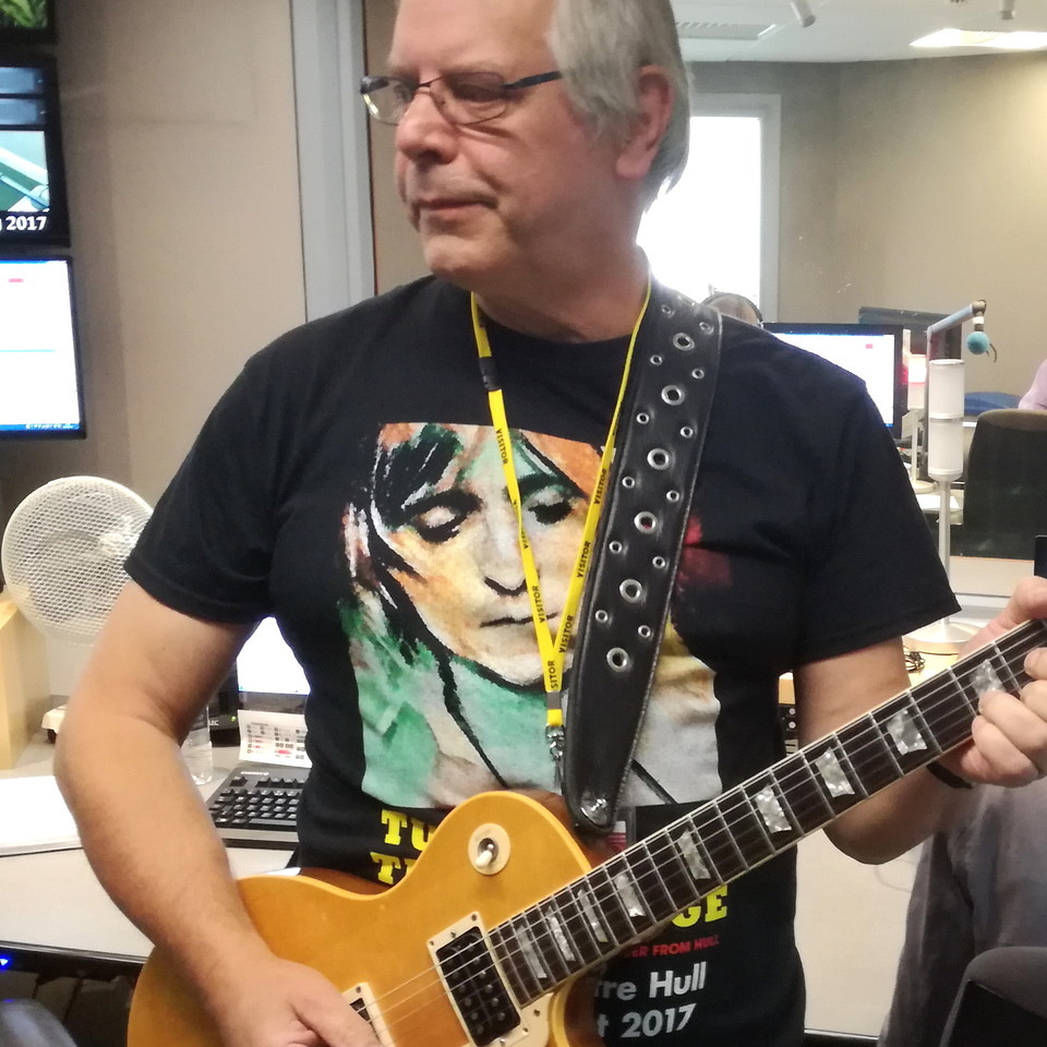 Musician Ched Cheesman with Mick Ronson Gibson Les Paul guitar for Turn And Face The Strange