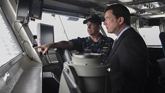 Capt. Buzz Donnelly, commanding officer of the USS Ronald Reagan (CVN 76), explaines flight deck operations to William F. Hagerty, U.S. ambassador to Japan, Sept. 6. (U.S. Navy/MC3 Macadam Weissman)