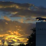Setting Sun over Jaguar sign Preston