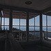 Small photo of Mt Rainier almost invisible from inside the lookout