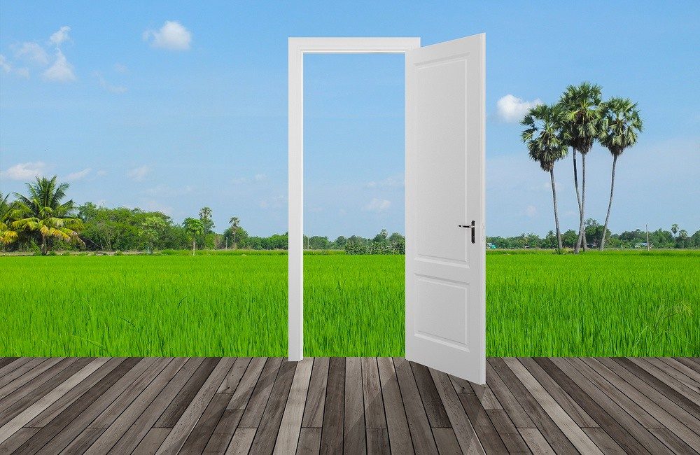 image of doorway amid a green landscape