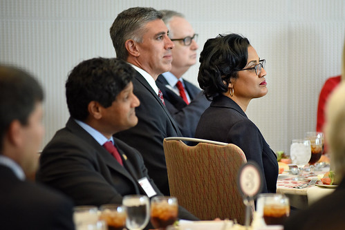 Board of Trustee member Gayle Lanier listens as the chancellor speaks at a lunch for the Board of Governors.
