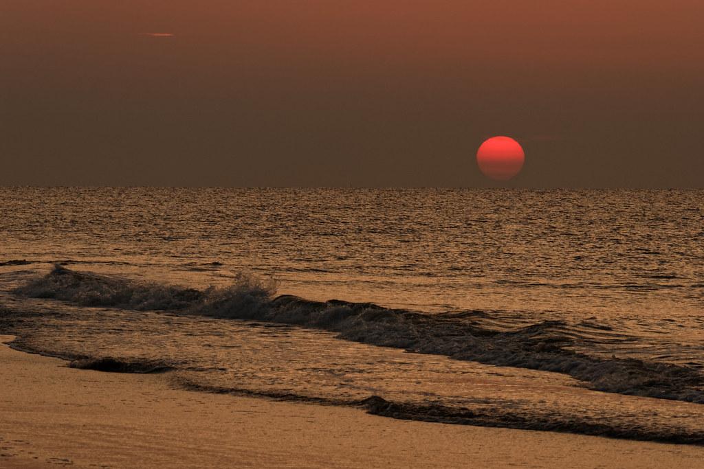 The sun rises above the Atlantic ocean at Huntington Beach State Park in South Carolina