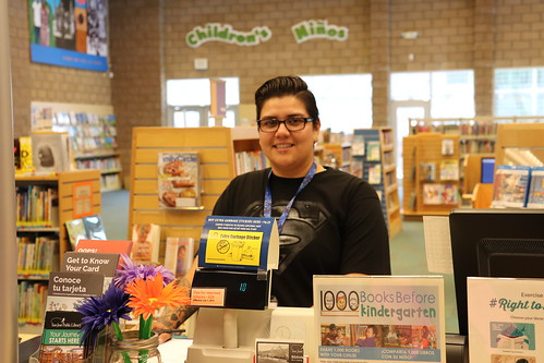Staff member at Desk | by San José Public Library
