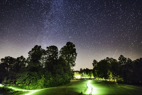 astronomy night sky milkyway andromeda galaxy m31 messier31 emission nebula stars dark bright trees forest woods lawn grass people torch flashlight walking planes tralis light longexposure