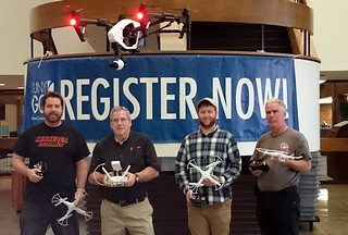 Sat, 11/19/2016 - 12:31 - Certified Instructor Norm Isler demonstrates flying a more advanced drone with three students in the Spring 2016 'Introduction to Drones' course.