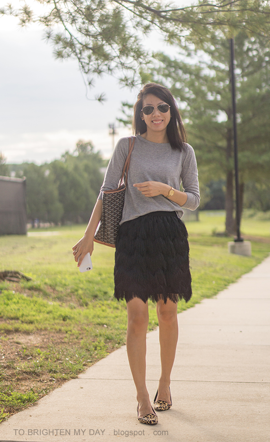 gray button back cardigan sweater, gold watch, patterned tote, black fringe skirt, leopard flats