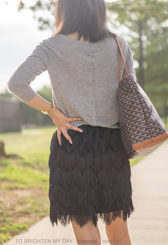gray button back cardigan sweater, gold watch, patterned tote, black fringe skirt