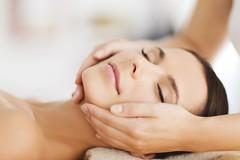 beautiful woman in spa salon having facial